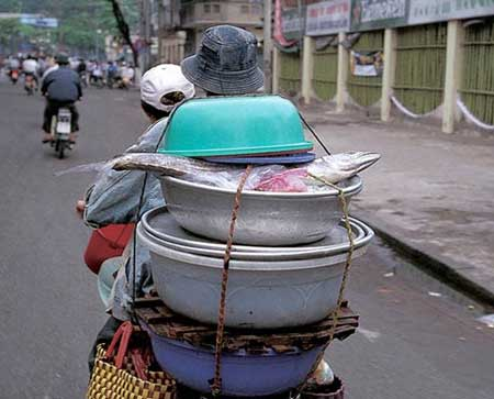 transporting fish on a moped