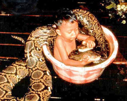 a boy and a snake taking a bath together