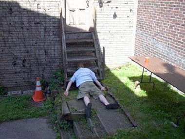 man face down at bottom of steps